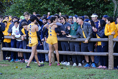 Belen Jesuit runners gets hugs and high-fives from their parents and school supporters after finishing the 5K race for the state cross country championship.