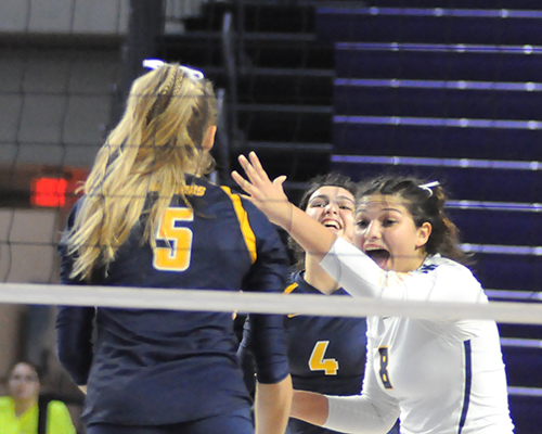 St. Thomas Aquinas libero Alyssa McBean, right, celebrates a point with Meredith Dixon (5) and Isabella Riquezes (4) during St. Thomas Aquinas' Class 6A girls volleyball state final vs. Tallahassee Leon, Nov. 15, 2019 at Suncoast Credit Union Arena in Fort Myers. Leon won the match 18-25, 25-10, 25-22, 26-24 for its second title.