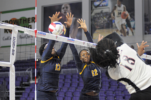 St. Thomas Aquinas blockers Zy'aire Barr, left, and Andi Cherenfant attempt to block Leon's Cailin Demps during St. Thomas Aquinas' Class 6A girls volleyball state final vs. Tallahassee Leon, Nov. 15, 2019 at Suncoast Credit Union Arena in Fort Myers. Leon won the match 18-25, 25-10, 25-22, 26-24 for its second title.