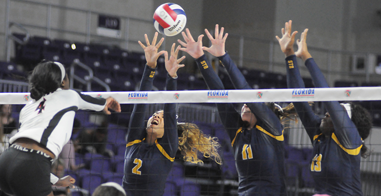 St. Thomas Aquinas blockers Mya Bowers (2), Kalin Hubbard (11) and Zy'aire Barr (13) try to block Leon's Shania Cromartie during St. Thomas Aquinas' Class 6A girls volleyball state final vs. Tallahassee Leon, Nov. 15, 2019 at Suncoast Credit Union Arena in Fort Myers. Leon won the match 18-25, 25-10, 25-22, 26-24 for its second title.