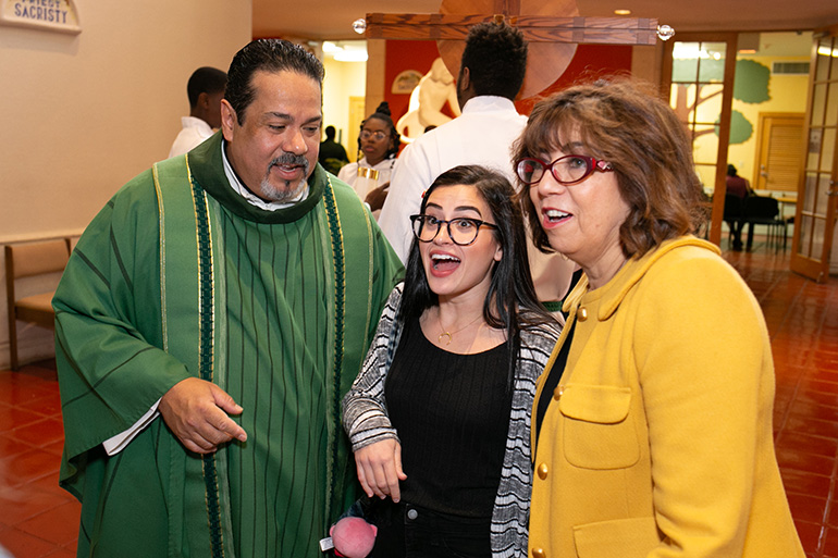 Chatting before the start of the 60th anniversary Mass, from left: St. Elizabeth of Hungary pastor Father Harry Loubriel, Lauren Cussell, a former school student, and Alicia McDermott, parish manager and a longtime parishioner.Archbishop Thomas Wenski celebrated the Mass marking the 60th anniversary of St. Elizabeth of Hungary parish, Pompano Beach, Nov. 17, 2019.