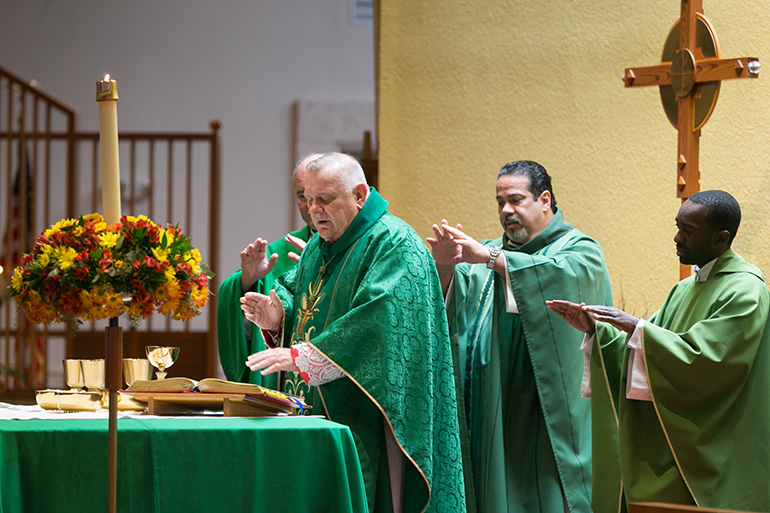 Archbishop Thomas Wenski celebrates the Mass marking the 60th anniversary of St. Elizabeth of Hungary parish, Pompano Beach, Nov. 17, 2019. Behind him, from left, are Father Harry Loubriel, pastor, and Father Fenly Saint-Jean, parochial vicar.