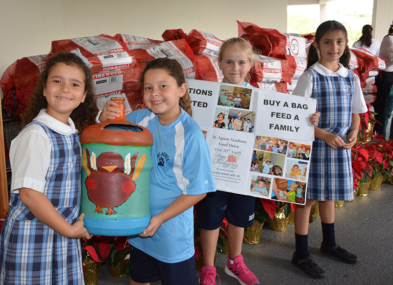 From left, St. Agnes Academy students Stella Roubach-Tomeo, Katerina Papadopoulos, Ana Viel Temperley, and Estefania Bejarano collected donations for the Thanksgiving Food Drive.    Pictured in photo 5:  Second grade students helped fill the bags with Thanksgiving food items.
