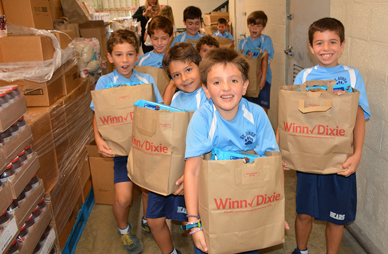 Second grade students at St. Agnes Academy helped fill the bags with Thanksgiving food items.