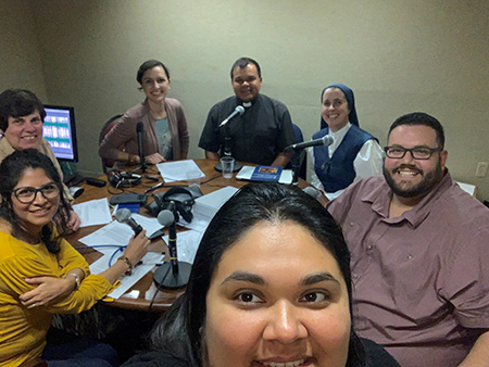 From right: Seminarian Sebastian Grisales, Sister Andrew Marie Tyler, and Father Elvis Gonzalez pose for a selfie during the taping of the podcasts,