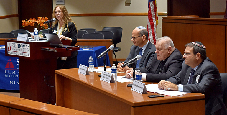 Law professor Rosa Pati puts questions to a panel of experts during a discussion on Vatican-Israel relations at St. Thomas University. The event honored the 25th anniversary of the Holy See's recognition of the Jewish state.