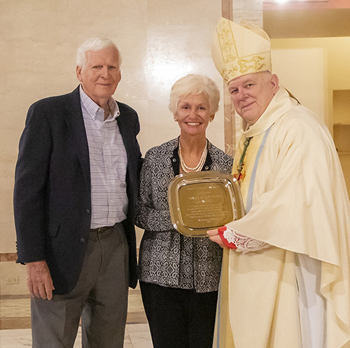 Archbishop Thomas Wenski gives Jim and Lourdes Cowgill, from the parish of St. Sebastian in Fort Lauderdale, the One in Hope award during the Thanks-for-Giving Mass celebrated at the Cathedral of St. Mary, Nov. 23, 2019.