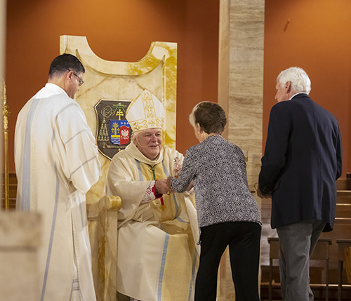 Archbishop Thomas Wenski receives the offertory from Jim and Lourdes Cowgill of St. Sebastian Parish in Fort Lauderdale. The couple received the One in Hope award during the Thanks-for-Giving Mass celebrated at the Cathedral of St. Mary, Nov. 23, 2019.