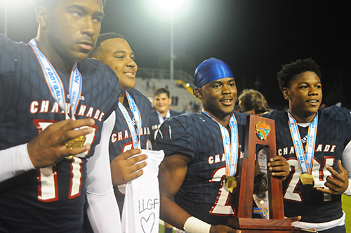 Players (from left) Claude Larkins, Kalun Matthew, Derek Geffrard and Charles Williams celebrate with the trophy after Chaminade-Madonna's 35-20 victory over Tallahassee Florida High Friday, Dec. 6, 2019, in the 2019 FHSAA 3A state football championship game at Gene Cox Stadium in Tallahassee. The Lions won their third consecutive state title and fifth overall.
