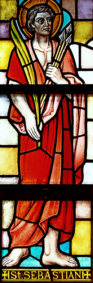 St. Sebastian carries a clutch of arrows plus a palm frond, two signs of his martyrdom, in this window at St. Sebastian Church, Fort Lauderdale.