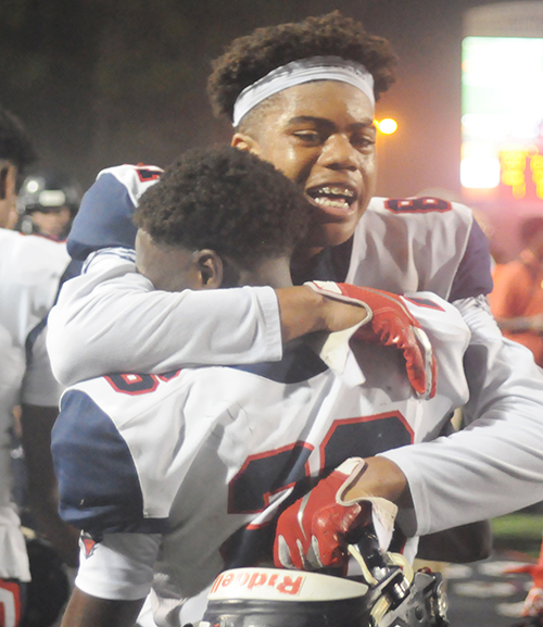 Columbus players Trynyty Conway and Jahvar McSween celebrate Christopher Columbus Catholic's 21-20 victory over Apopka in the Class 8A state football championship game at Daytona Stadium. The Explorers won their first state title after going 0-5 in previous finals.