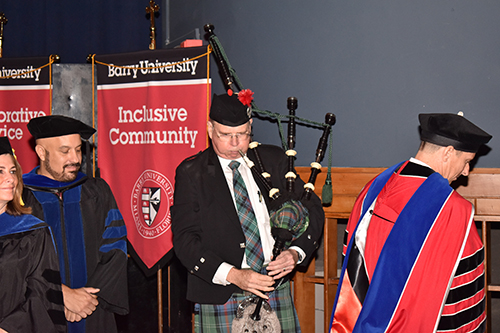 Charles Southerland, a professor of podiatric medicine, supplies traditional bagpipe music for the inauguration of Mike Allen as president of Barry University.