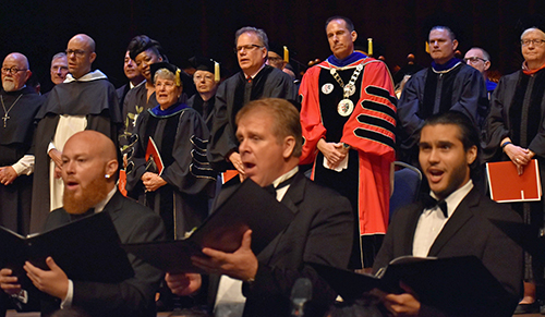 Mike Allen listens to the singing of the Barry University alma mater after his inauguration as the university's new president.