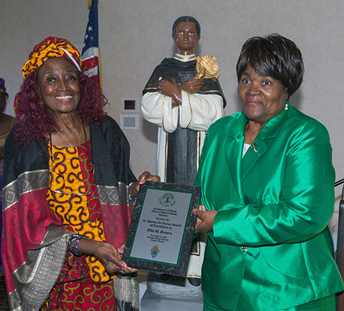 Eleanor Gardner, left, poses with Ella Brown, St. Martin de Porres Award of Excellence recipient from Visitation Church, North Miami. The awards were presented by the Office of Black Catholics of the archdiocese at the annual Black Catholic History Month awards luncheon, held at the Stadium Hotel in Miami Gardens, Nov. 16 2019.