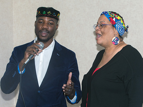 """Dave McFarlane and Tamara Hospedales, of the archdiocesan Office of Black Catholic Ministry choir, perform a duet of """"Agnus Dei"""" at the annual Black Catholic History Month awards luncheon, held at the Stadium Hotel in Miami Gardens, Nov. 16 2019."""