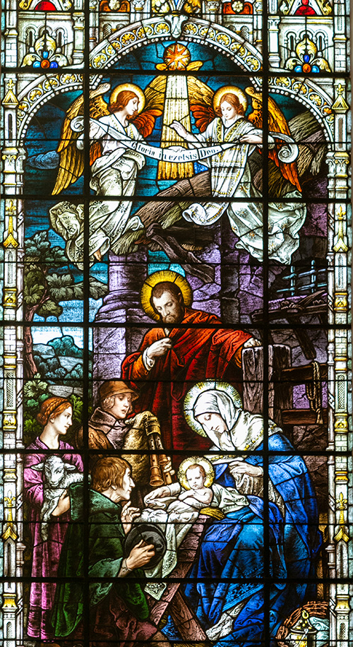 Stained glass image of the Nativity at Gesu Church in downtown Miami. Cover of December 2019 edition of Florida Catholic, Miami.