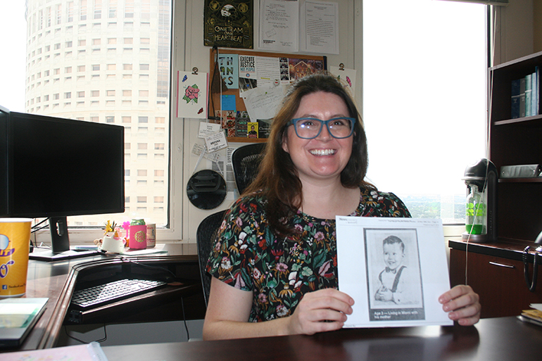 Sitting in her office at the Federal Public Defender Office in Tampa, attorney Brenna Egan holds up a photocopy of a picture taken of Bobby Joe Long when he was 3-years-old. Egan said the photo represents her client's humanity, who was once a little boy.
