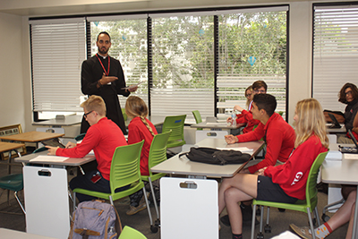 Piarist Father Ricardo Rivera connects with senior students in the classroom during theology lessons at Cardinal Gibbons High in Fort Lauderdale.