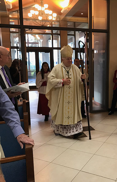 Archbishop Thomas Wenski processes into St. Henry Church for the Mass concluding the parish's year-long celebration of its 50th anniversary, Jan. 11, 2020.