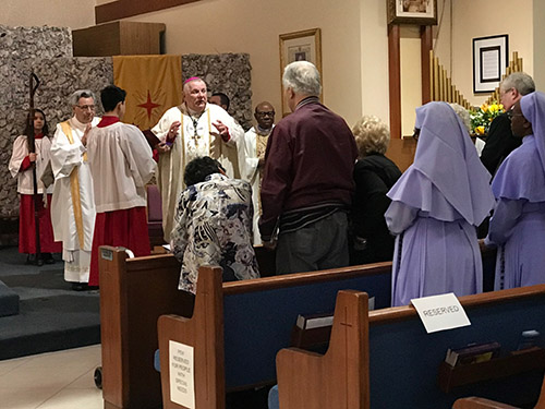 Archbishop Thomas Wenski celebrates the Mass marking the conclusion of St. Henry Parish's year-long celebration of its 50th anniversary, Jan. 11, 2020.