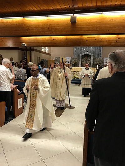 Archbishop Thomas Wenski exits St. Henry Church after the Mass marking the conclusion of the parish's year-long celebration of its 50th anniversary, Jan. 11, 2020. Walking in front is St. Henry's pastor, Spiritan Father Francis Akwue.