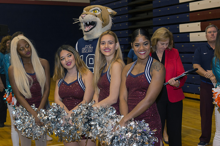 St. Thomas University cheerleaders and mascot pose for the camera at the NFL Super Kids-Super Sharing Super Bowl community impact project, Jan. 16, 2020 at St. Thomas University. The project puts lightly used sports equipment and school supplies into the hands of schools in need.
