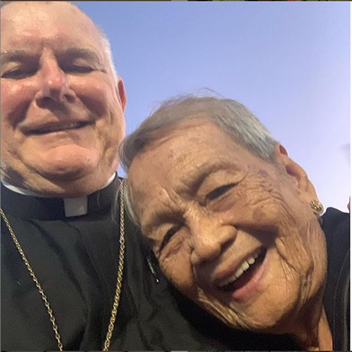 """Archbishop Thomas Wenski took this selfie with Liza, a """"Pinay"""" - Filipina lady - who recently celebrated her 100th birthday. She was attending Santo Niño Mass at St. Bernard Church in Sunrise, Jan. 19, 2020."""
