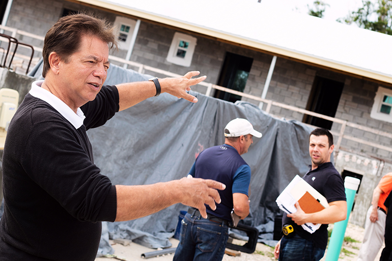 Peter Routsis-Arroyo, director of Catholic Charities of the Archdiocese of Miami, makes a point during a recent tour of the construction site for a new Catholic Charities-sponsored St. Bede's Village workforce development facility in Key West, expected to be completed as early as next summer.