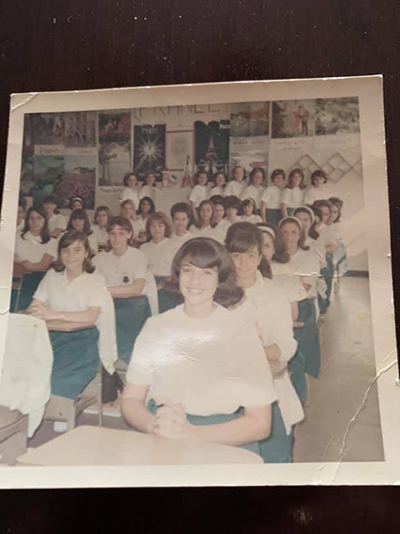 Elsa Reus, second from right, front, and former classmate Vivian Toscano, seated behind her, can be seen in this picture from their days as students in Mrs. Hermo's French class, 50 years ago at Notre Dame Academy in Miami. The alums made a return trip to their alma mater - now the Pierre Toussaint Haitian Center - Nov. 17, 2019.