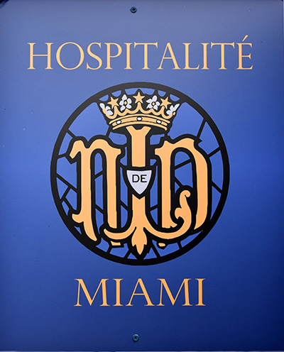 Hospitalité de Miami is so central to the mission at Our Lady of Lourdes Church, the group has its own meeting room, marked with a large plaque.