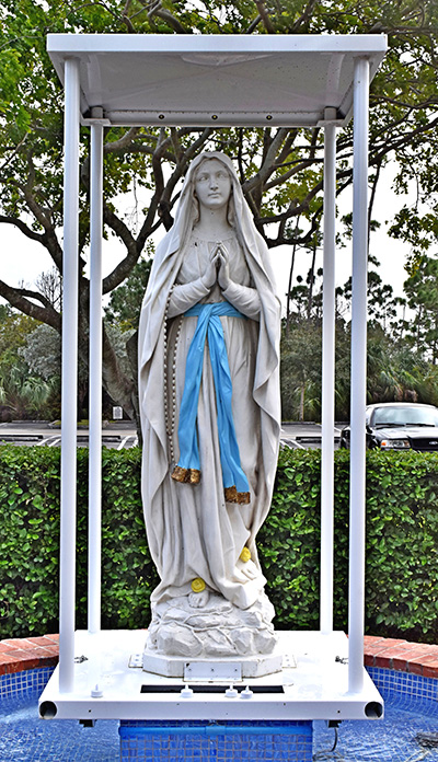 This statue of Mary is carried in monthly outdoor processions at Our Lady of Lourdes Church, Miami.