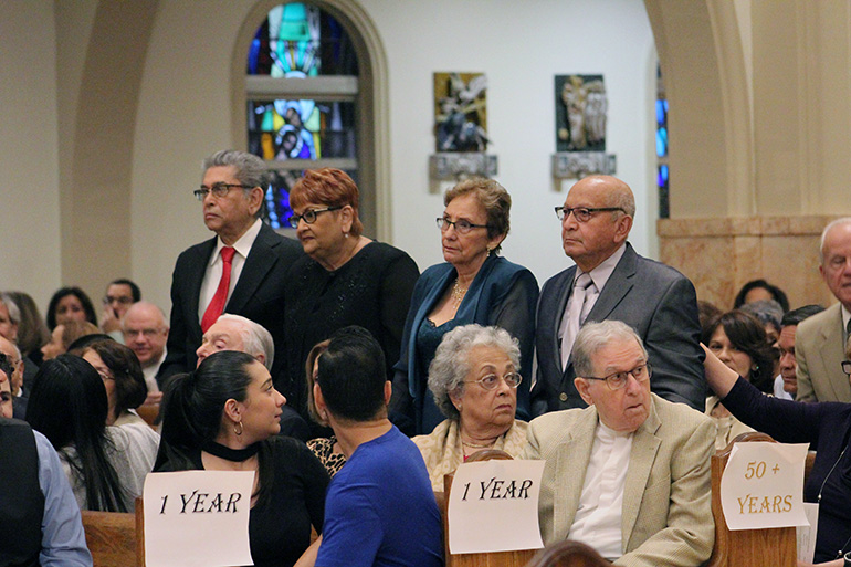 Couples celebrating 60 years or more of marriage stand and are recognized at the wedding anniversary Mass celebrated at St. Mary Cathedral Jan. 25, 2020.