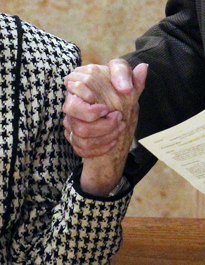 Couples hold hands as they renew their marriage vows at the wedding anniversary Mass celebrated at St. Mary Cathedral Jan. 25, 2020.