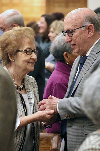 As on the day of their wedding, couples hold hands and face each other as they renew their marriage vows at the wedding anniversary Mass celebrated at St. Mary Cathedral Jan. 25, 2020.