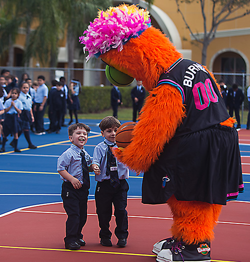 Heat mascot Burnie entertains Jonathan Hecht, 3, and his brother, Sebastian Hecht, 5, after the blessing of Mother of Our Redeemer School's new basketball-volleyball court, Jan. 27, 2020.