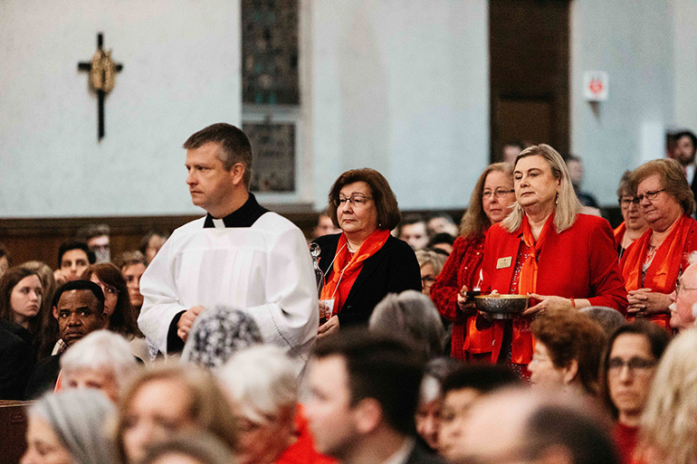 Members of the diocesan Councils of Catholic Women, including Miami's president, Lisa Shelly, front left, take up the offertory during the 45th annual Red Mass of the Holy Spirit which concluded the 2020 Catholic Days at the Capitol.