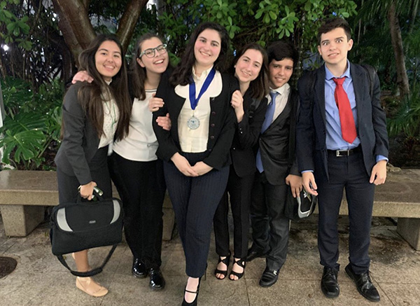 Immaculata-La Salle senior Isabella Perez, pictured here with fellow debate team members, is headed to the state competition after earning second place at the district debate tournament Feb. 2, 2020.