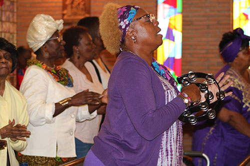 Participants join in to praise and worship the Lord during 