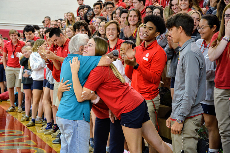 Holocaust survivor Bernard Igielski hugs a Cardinal Gibbons student after his talk to juniors and seniors at the school Feb. 20, 2020.