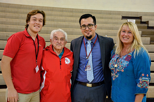 Cardinal Gibbons senior Michael Field poses with his neighbor, Holocaust survivor Bernard Igielski, along with Gibbons principal Oscar Cedeño and Yelena Ilyina, Michael's mother.
