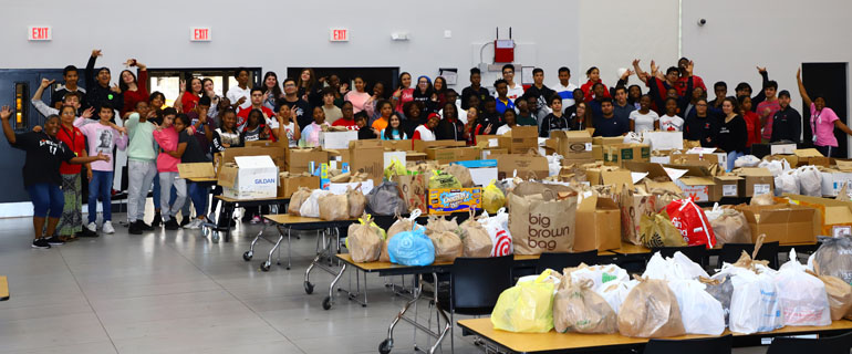 Msgr. Edward Pace High students gather for a group shot after packing over 3,500 meals for the homeless. The efforts come as part of the pre-Lenten event Hungerfest, where participants combine their own fasting with prayers and meal prepping and packing.