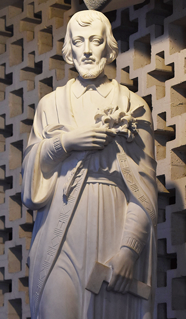Statue of Joseph is on the other side of the chancel at St. Rose of Lima Church, Miami Shores. The hammer in his left hand shows his vocation as a carpenter.