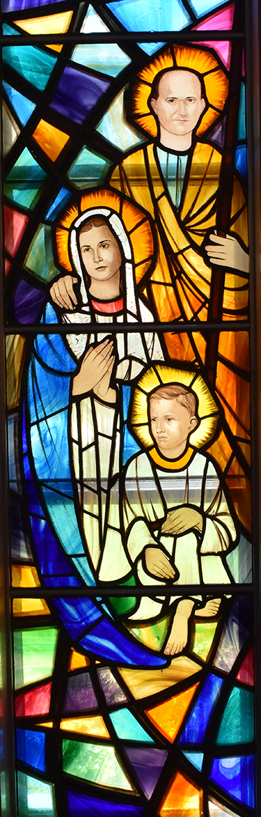 The religious store windows at St. Rose of Lima, Miami Shores, show old-style themes, but with modern faces. Here's a rendering of the Holy Family.