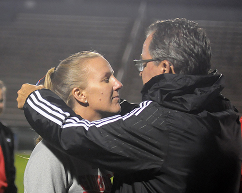 Cardinal Gibbons athletic director Michael Morrill, right, gives Chiefs girls soccer head coach Margo Flack a silver medal for her team's runner-up finish in FHSAA Class 4A girls soccer. The Chiefs fell to Jacksonville Bishop Kenny 2-1 in the 4A girls final, Feb. 26, 2020, at Spec Martin Stadium in DeLand.