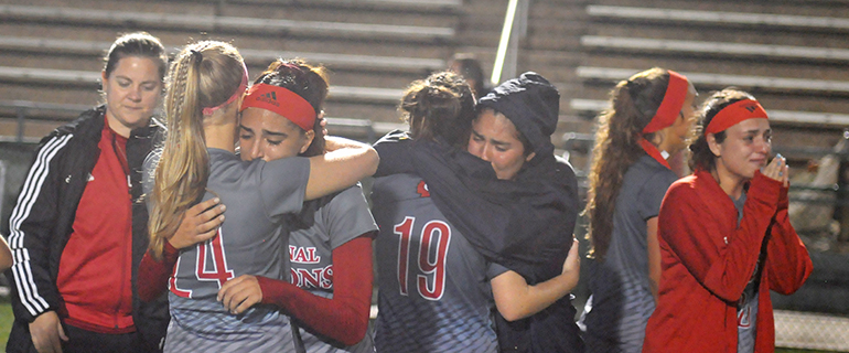 Cardinal Gibbons girls soccer players share in their sadness after falling to Bishop Kenny 2-1, Feb. 26, 2020 in the FHSAA Class 4A girls soccer state championship match at Spec Martin Stadium in DeLand.