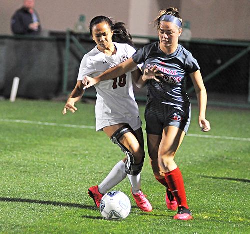 Cardinal Gibbons defender Heather Astle, right, and Bishop Kenny midfielder Sophia Hayag battle for the ball during the second half of the Feb. 26, 2020 FHSAA girls soccer state-championship match at Spec Martin Stadium in DeLand. Bishop Kenny won 2-1.