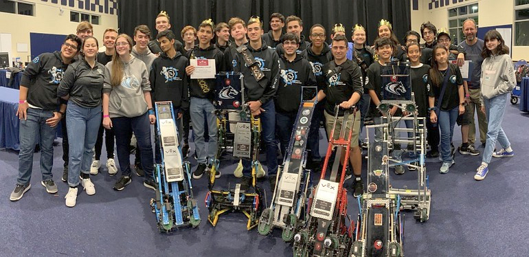 Members of McCarthy High School's team Maverick Robotics show off their machines and awards after winning the state championship Feb. 29 at Florida International University.