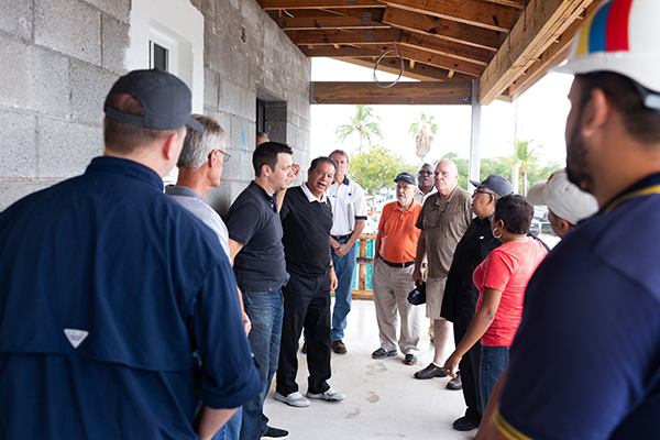 In this file photo from November 2019, Peter Routsis-Arroyo, director of Catholic Charities of the Archdiocese of Miami, center, speaks during a recent tour of the construction site for a new Catholic Charities-sponsored St. Bede's Village workforce development facility in Key West, expected to be completed as early as next summer. Local agencies are worried about the effects of the COVID-19 pandemic on local homeless populations.