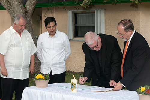 Signing the papers that transfer the La Salle Educational Center's relationship from the Lasallians' Antilles-Mexico South district to the Eastern North America district, from left: Brother Pedro Alvarez Arena, Brother Rafael Ceron Castillo, Brother Dennis Lee and Alan Weyland.