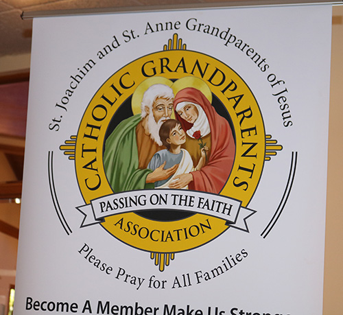 A poster featuring the Holy Family is part of the displays at a meeting held Feb. 20, 2020 at Assumption Parish in Lauderdale-By-The-Sea. The meeting was designed to inform participants about a new ministry aimed at helping and supporting grandparents in archdiocesan parishes.